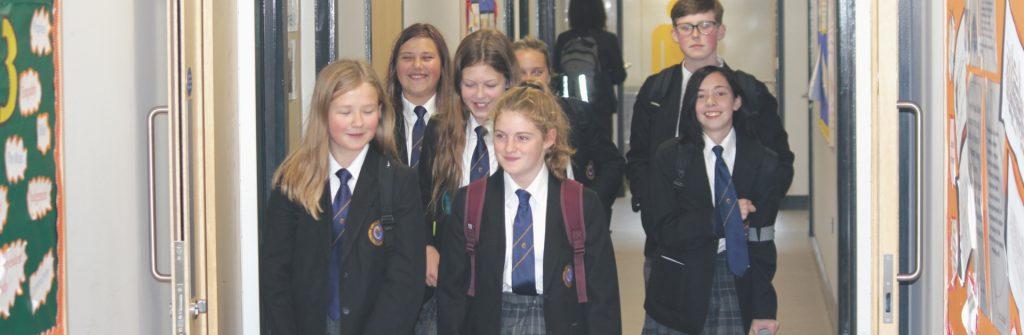 Our Organisation-Header image of School children walking down corridor